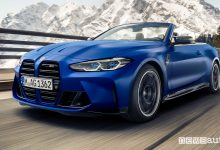 Vista di profilo BMW M4 Competition Cabrio su strada